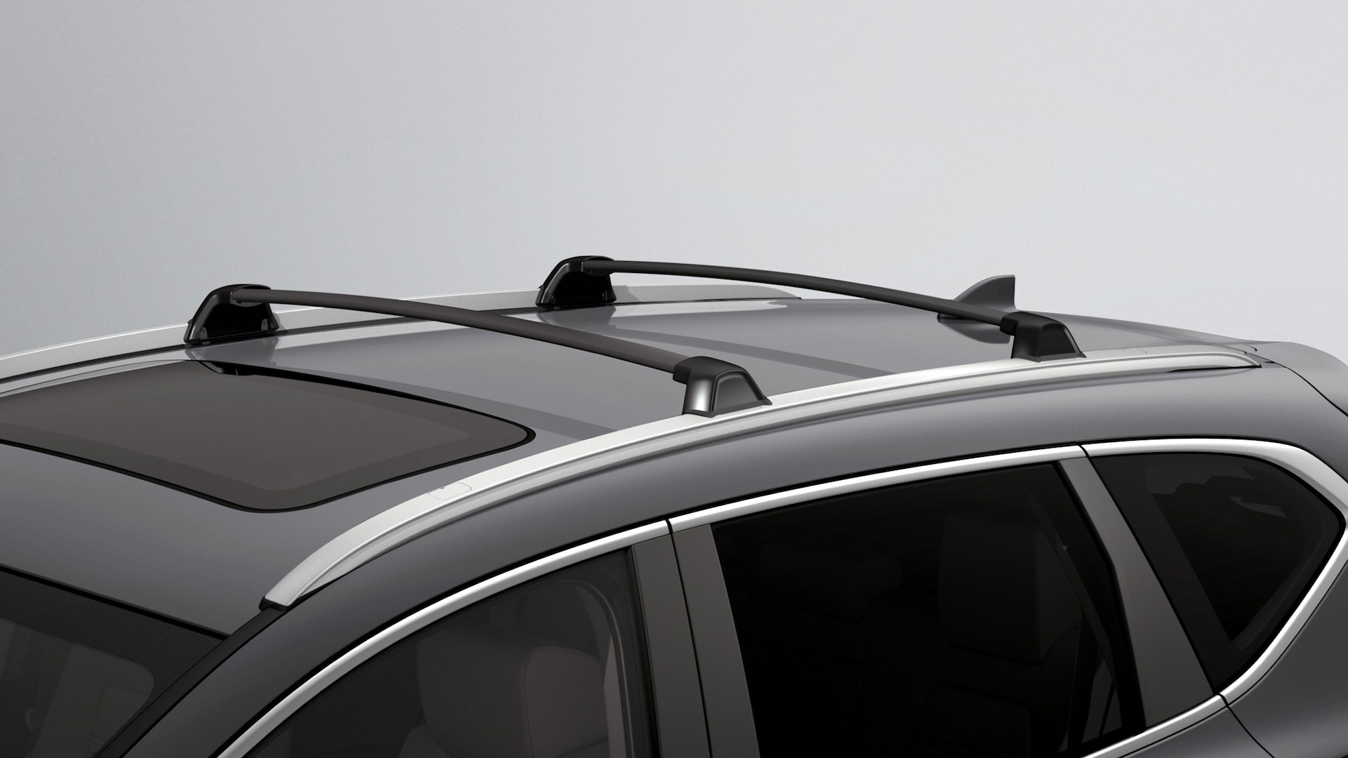 Honda Genuine Accessory roof rails and crossbars detail on the 2020 Honda CR-V in Sonic Gray Pearl.