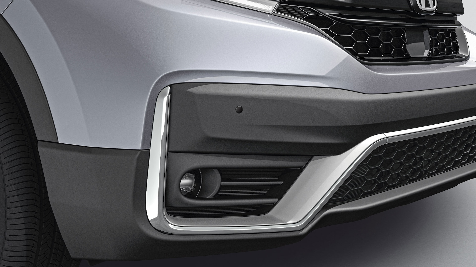 Rear ¾ passenger-side close-up view of 2020 Honda CR-V in Sonic Gray Pearl with sport bumper.