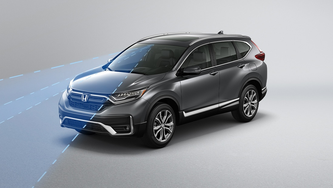 Front 3/4 driver-side of 2020 Honda CR-V Touring in Modern Steel Metallic demonstrating Road Departure Mitigation System.