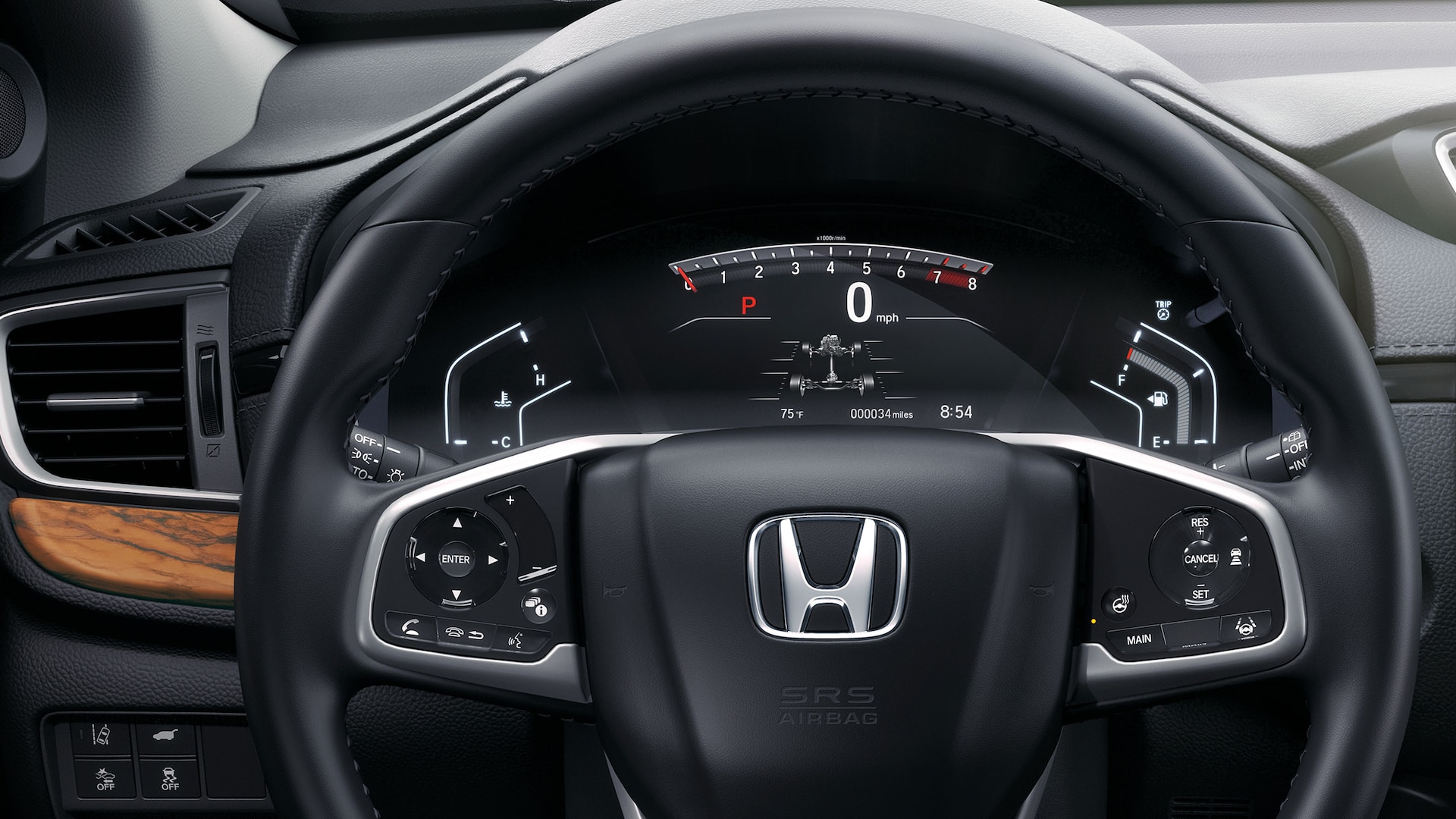Interior view of the 2020 Honda CR-V with Honda Genuine Accessory heated steering wheel and control switch.