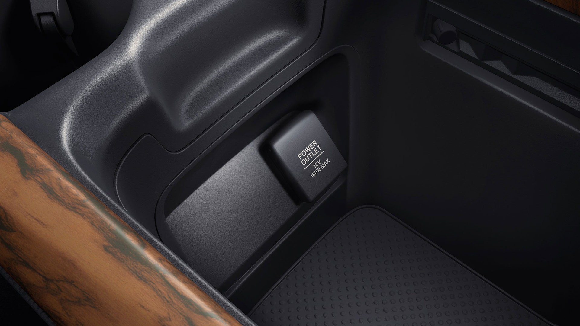 Interior view of 12-volt power outlet in the 2020 Honda CR-V.