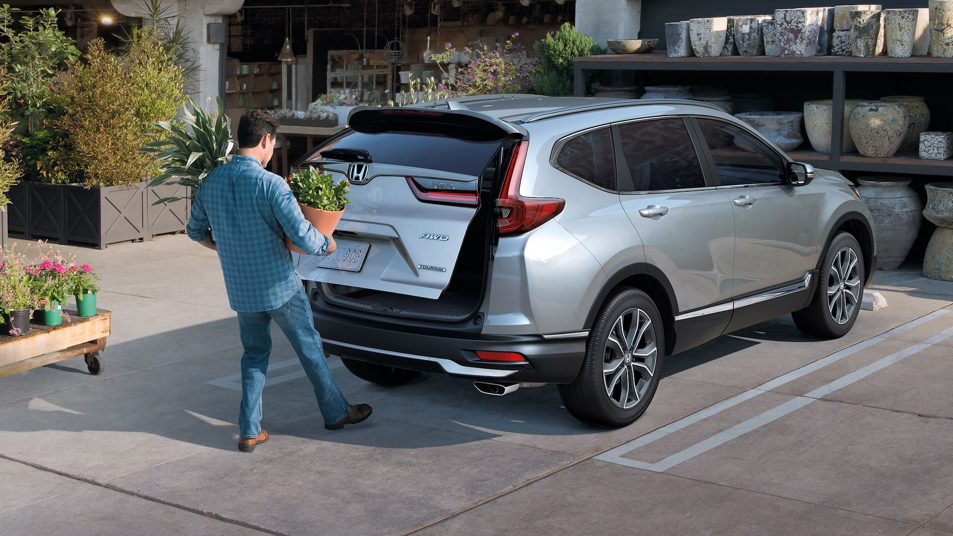 Rear passenger-side view of the 2020 Honda CR-V Touring in Lunar Silver Metallic demonstrating hands-free access power tailgate.