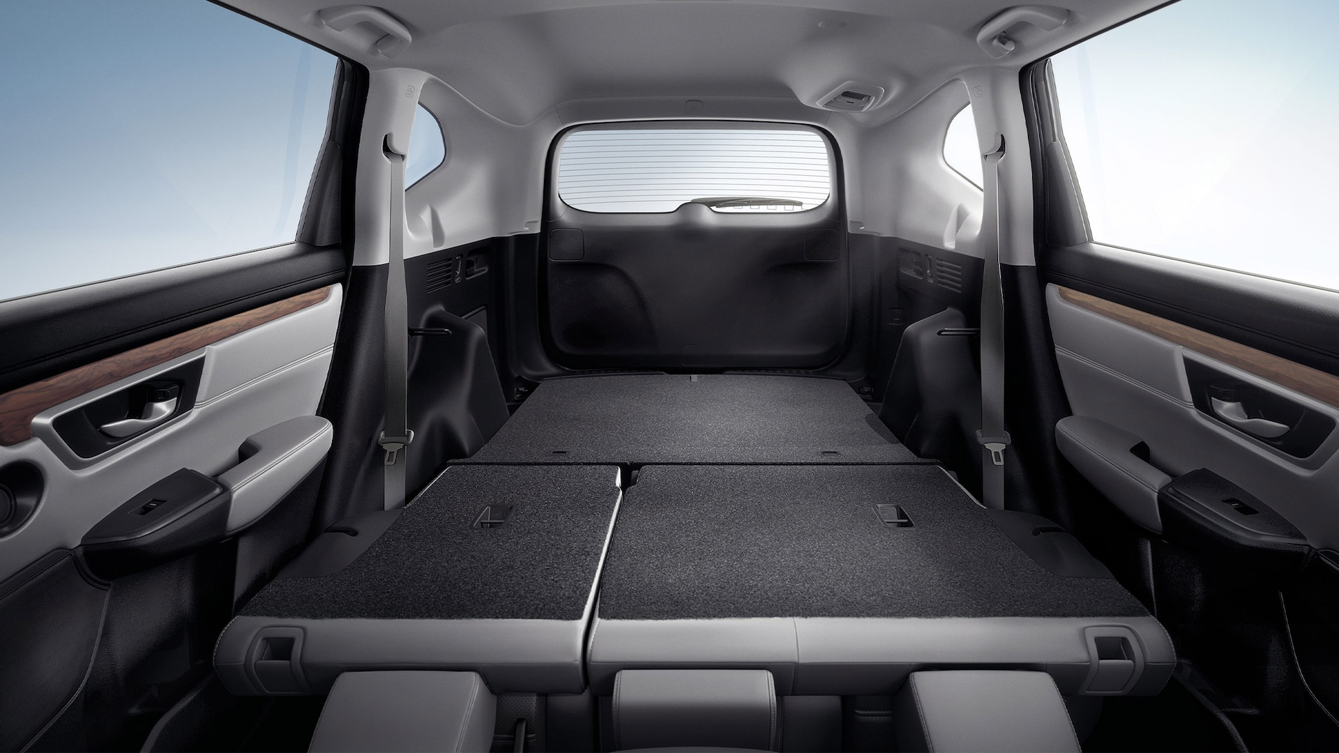 Interior view of 2020 Honda CR-V with Gray Leather demonstrating easy fold-down 60/40 split rear seatback.