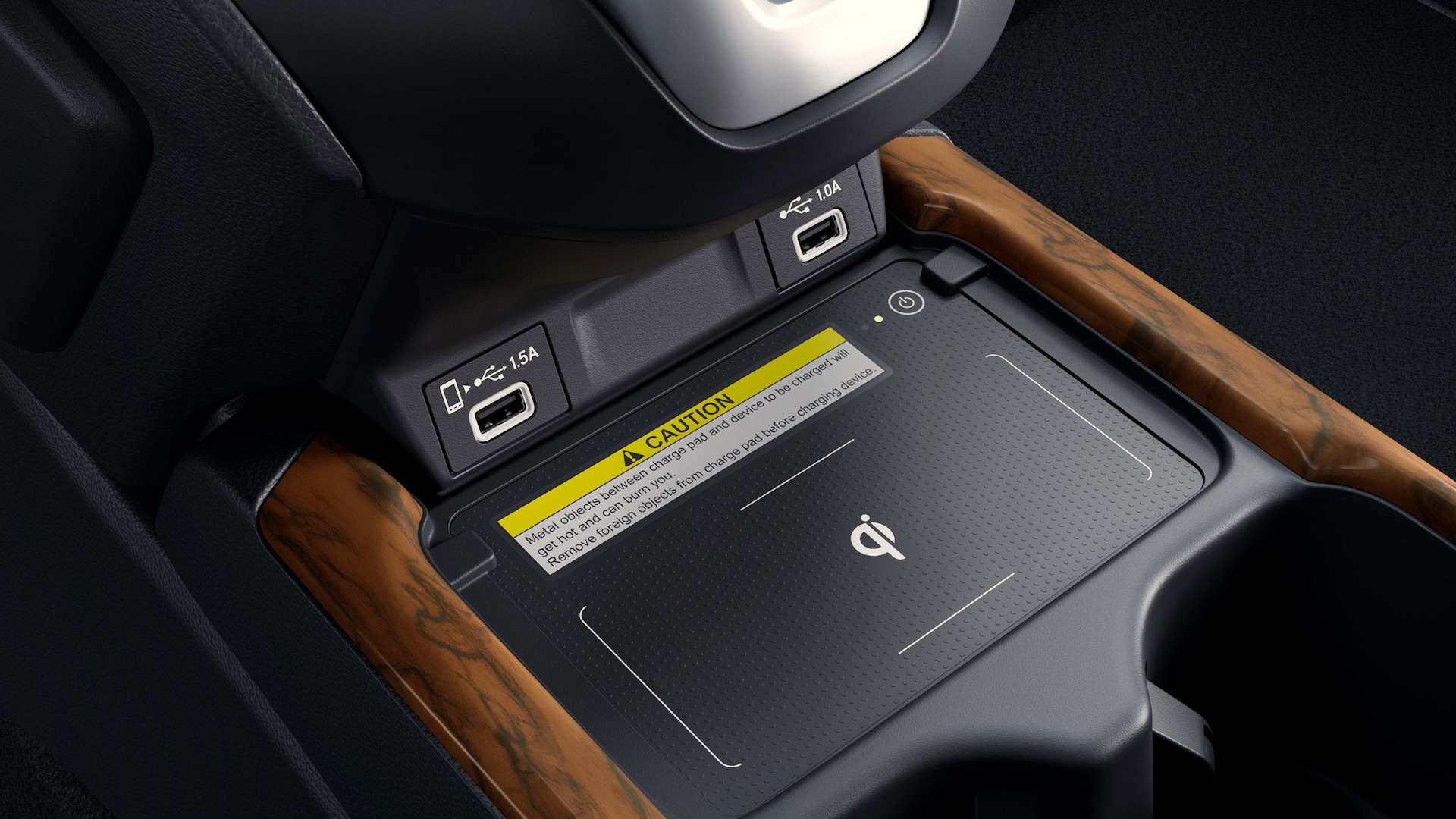 Detail view of USB ports and wireless phone charger in the 2020 Honda CR-V Touring.