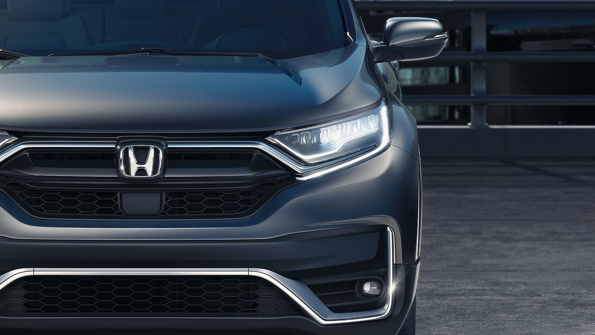 Front close up view of 2020 Honda CR-V Touring with full LED headlights with auto-on/off.