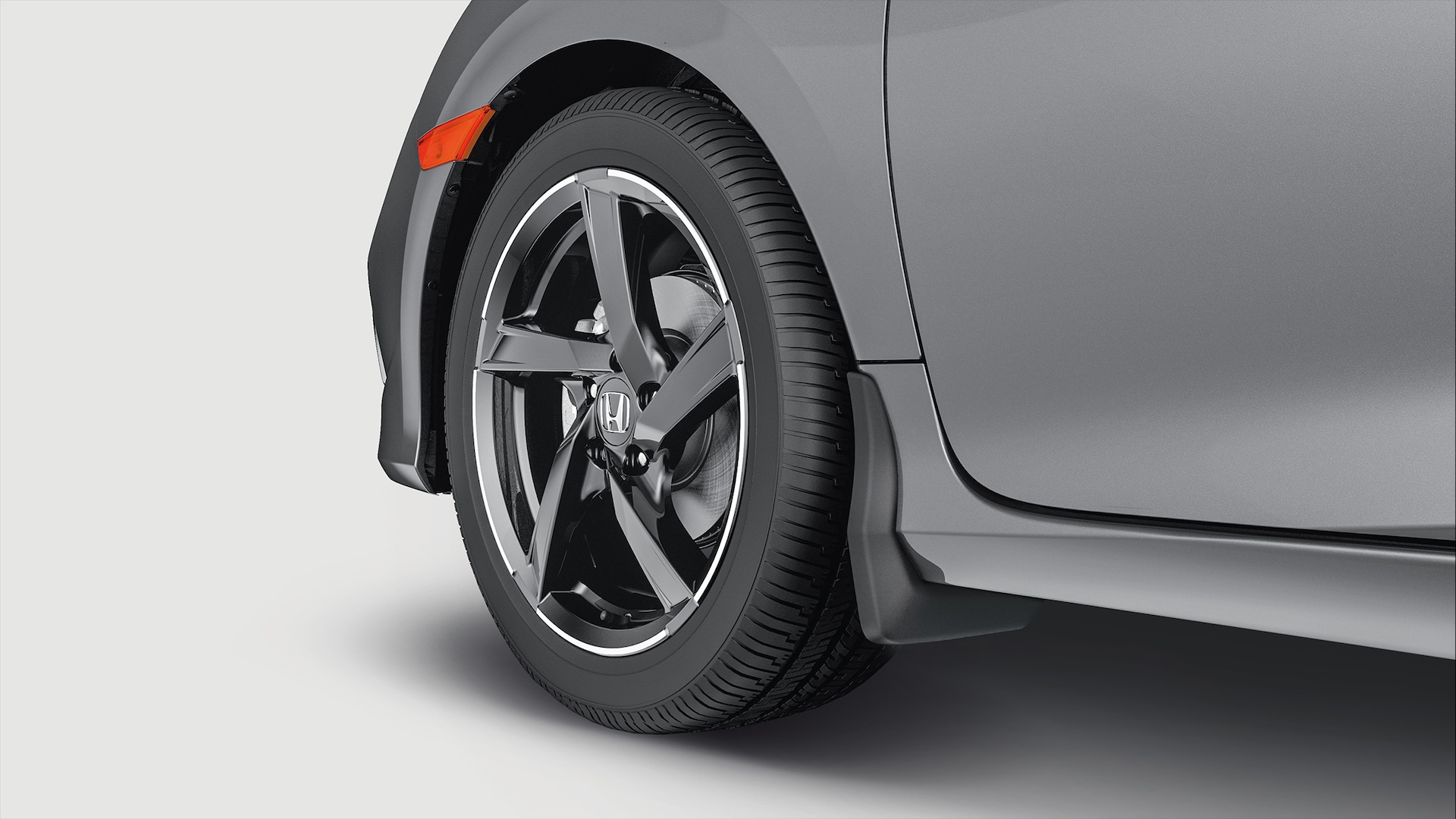 Accessory 18-inch, 5-spoke black alloy wheel detail on the 2020 Honda Civic Coupe in Modern Steel Metallic.