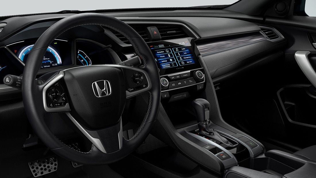 Interior driver-seat view of instrument panel in the 2020 Honda Civic Touring Coupe with Black Leather.