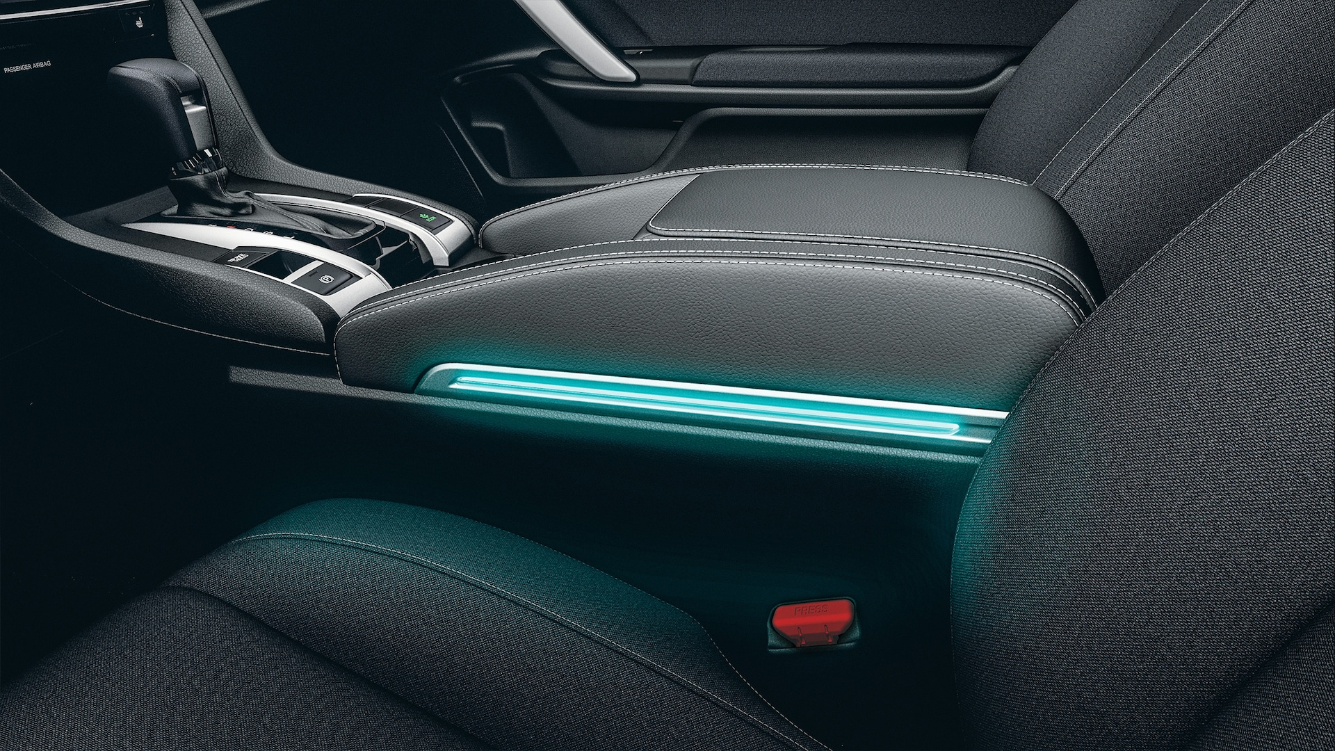 Accessory armrest illumination detail in the 2020 Honda Civic Coupe.