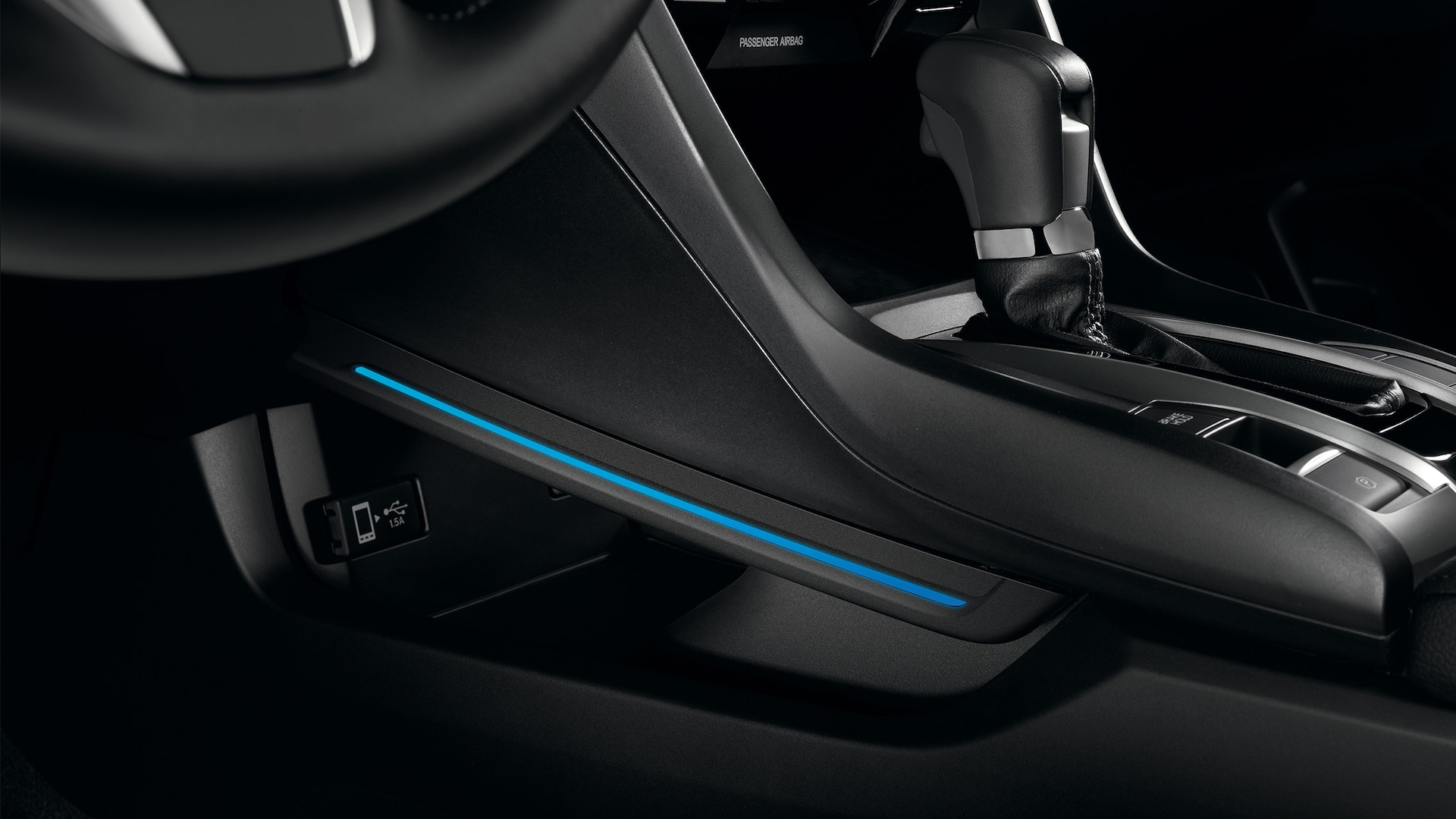 Accessory interior console illumination detail in the 2020 Honda Civic Coupe.