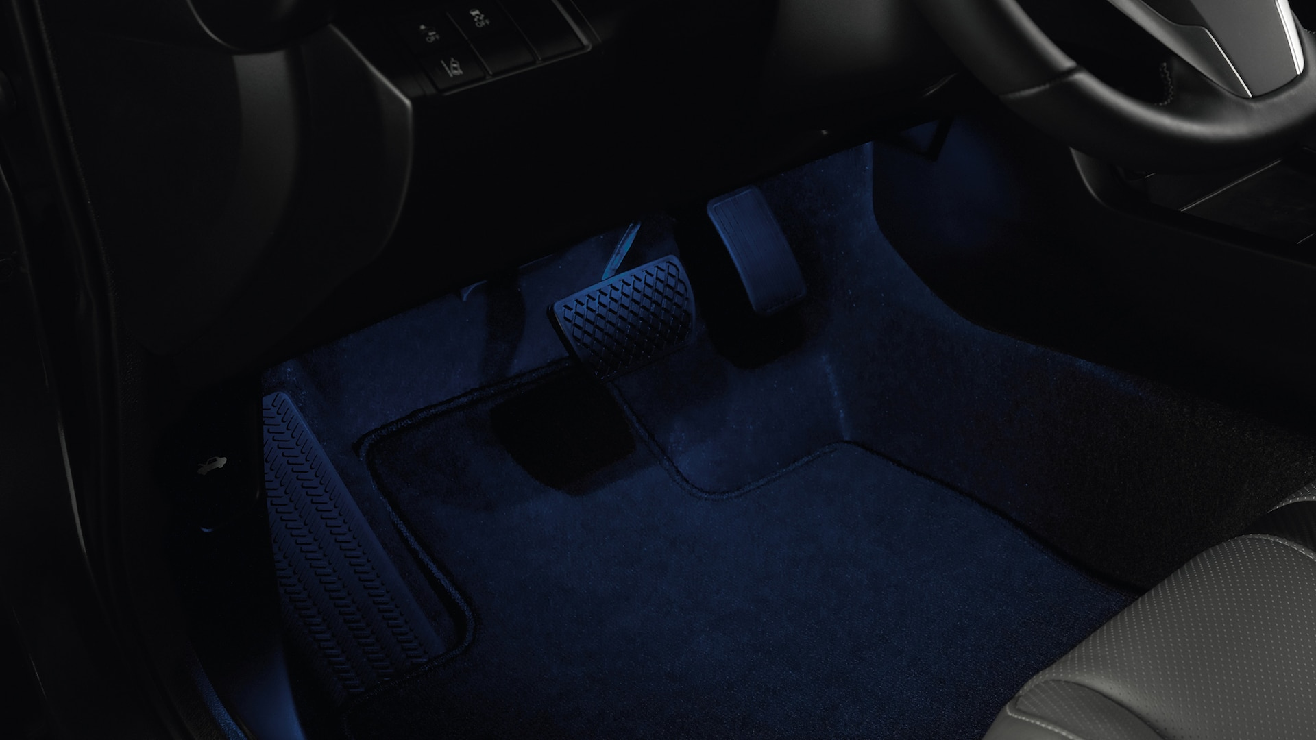 Accessory interior illumination detail on driver-side floor in the 2020 Honda Civic Coupe.