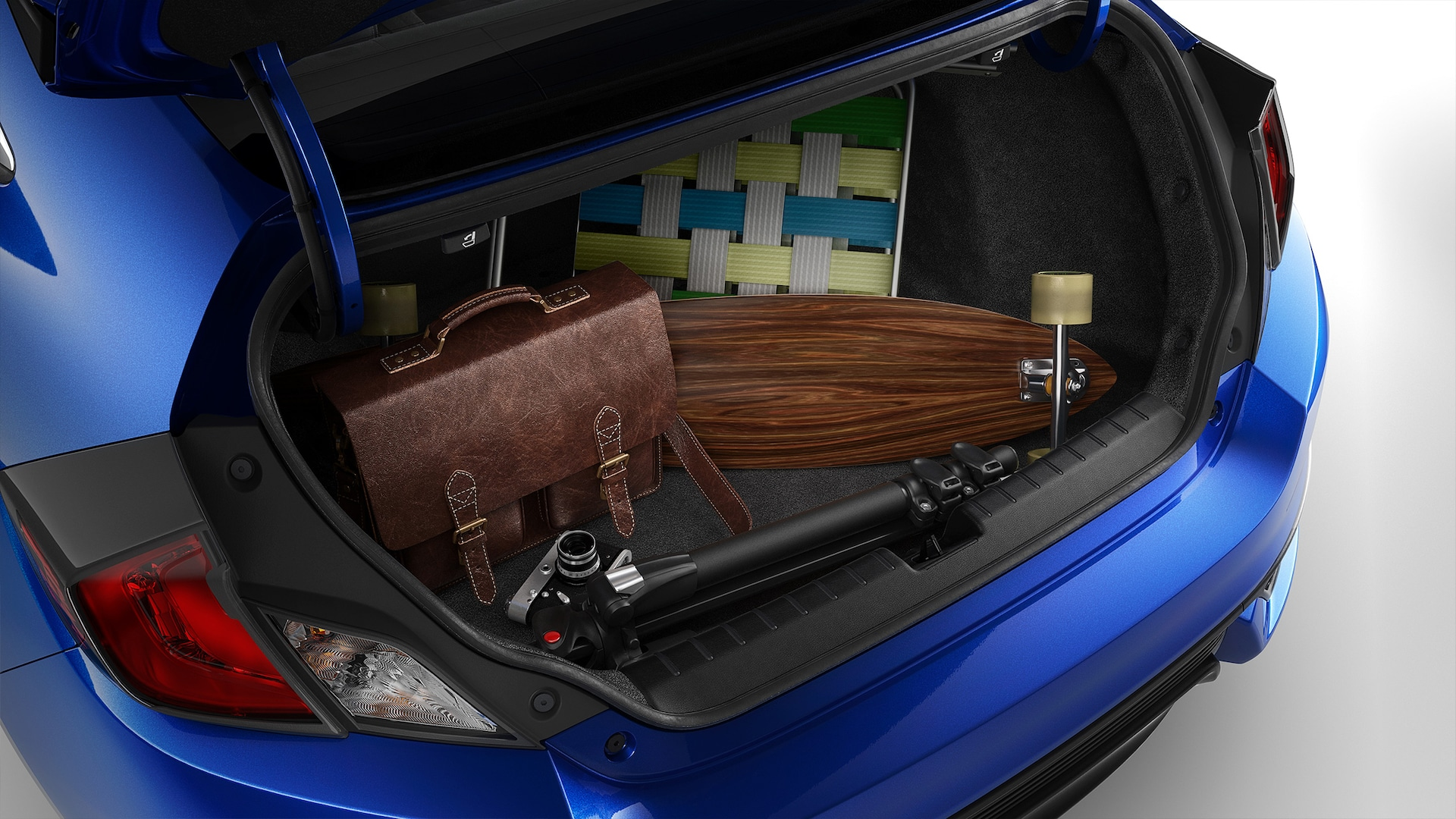 Open trunk detail of the 2020 Honda Civic Touring Coupe with various everyday items inside.