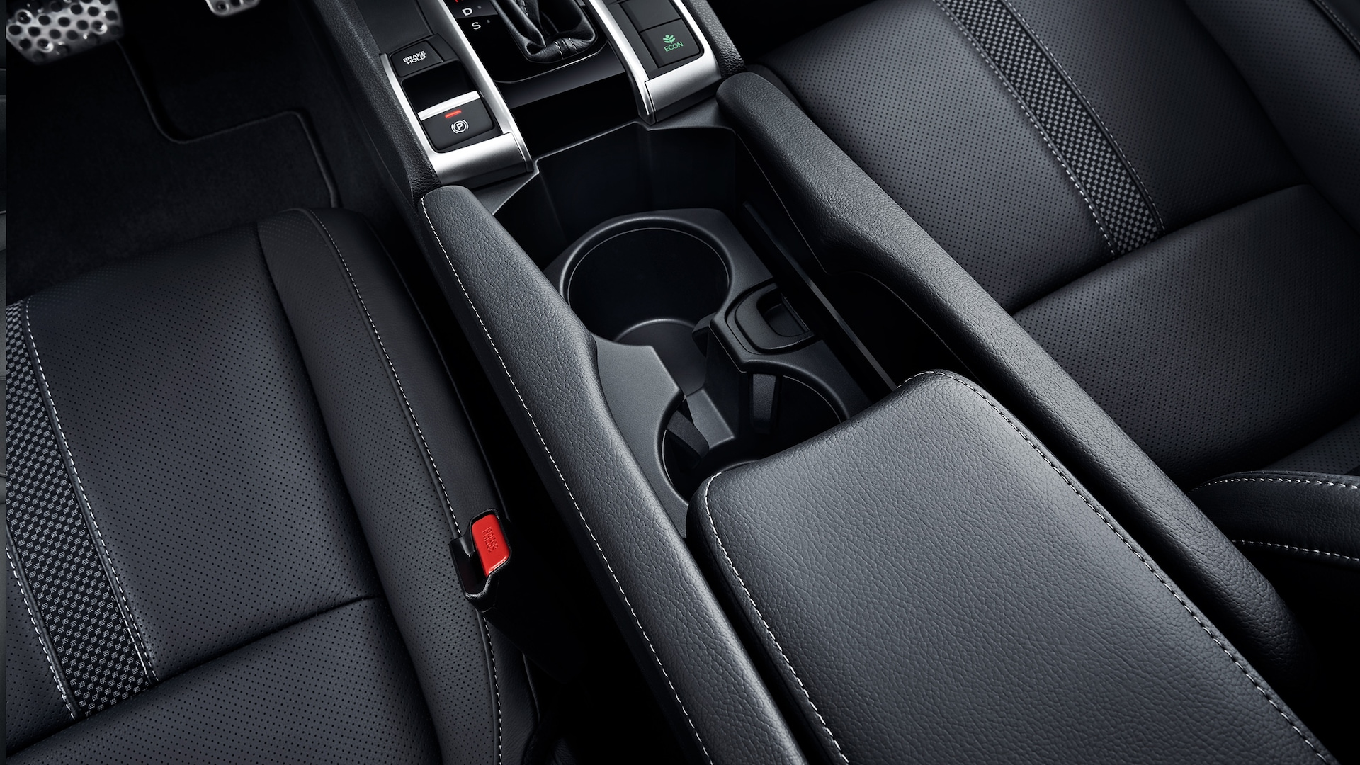Center console detail with cupholders in the 2020 Honda Civic Coupe.