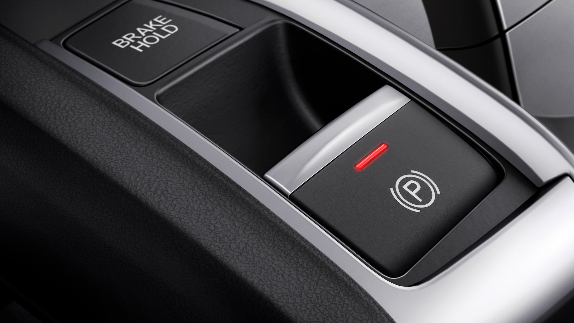 Electric parking brake detail in the 2020 Honda Civic Coupe.