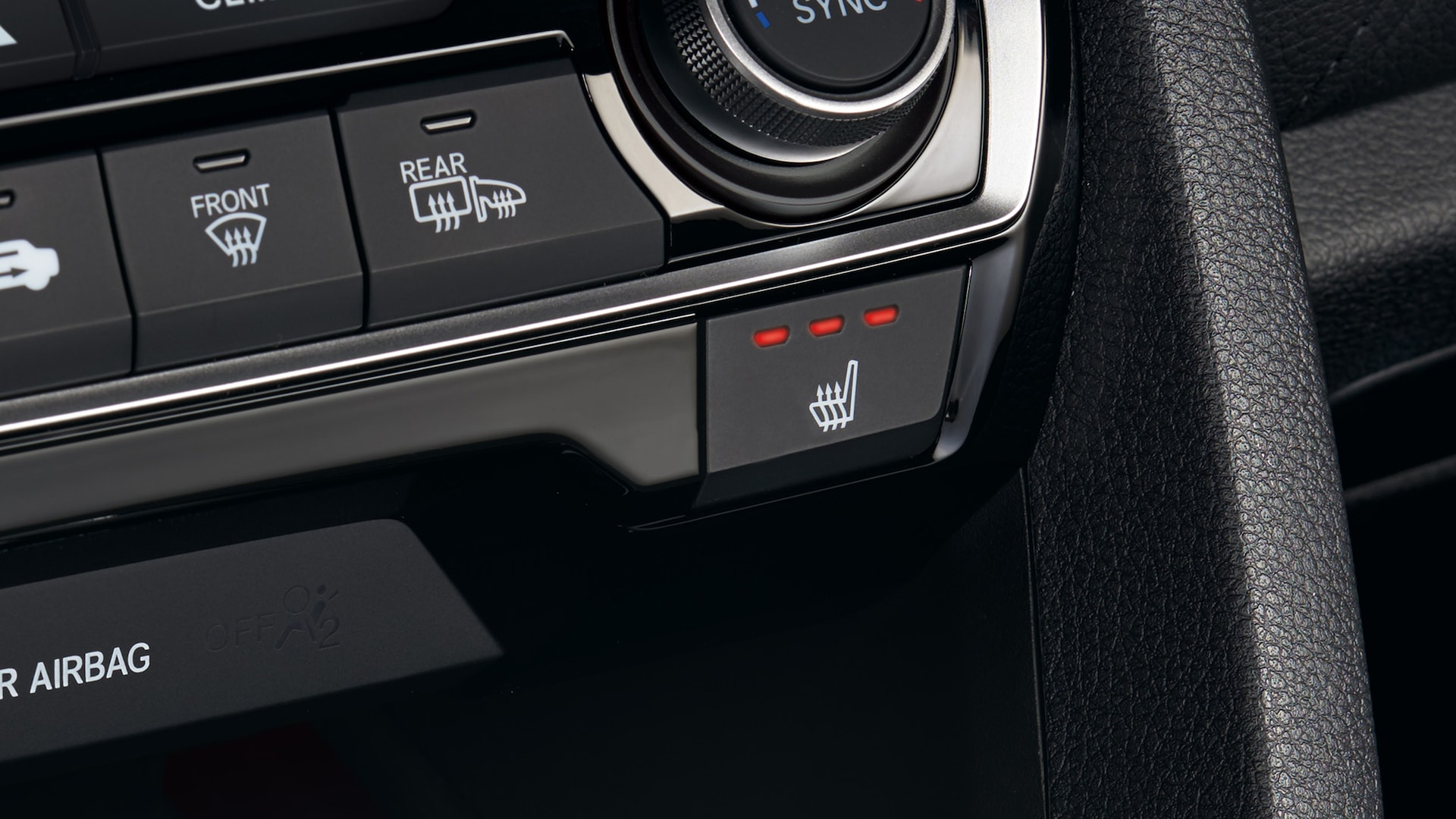 Button detail for heated front seats activated in the 2020 Honda Civic Coupe.