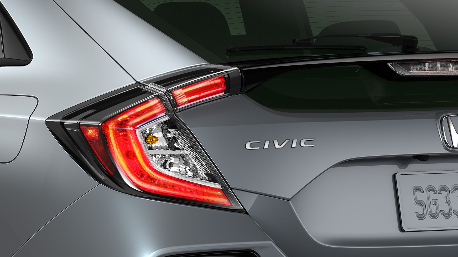 Detail of driver-side taillight on the 2021 Honda Civic Sport Touring Hatchback in Sonic Gray Pearl.