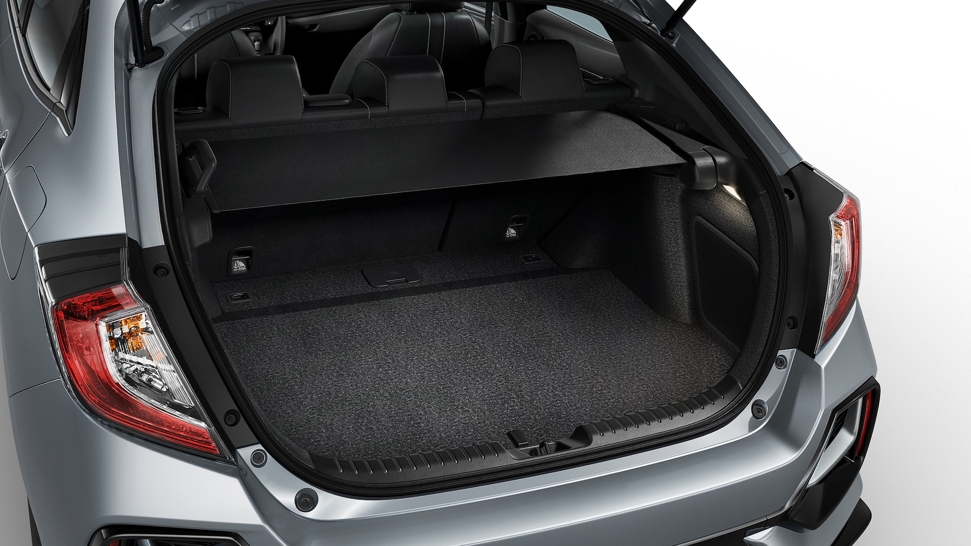 Cargo area of 2020 Honda Civic Sport Touring Hatchback with cargo cover extended.