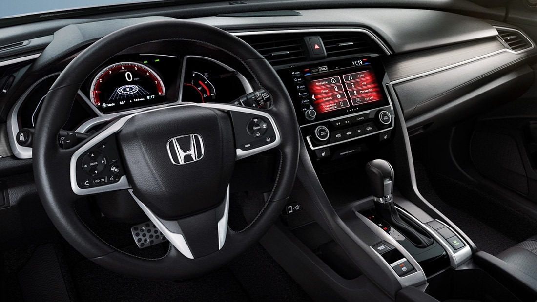 Interior passenger-side profile view of front seats and dash on 2020 Honda Civic Sport Touring Hatchback.