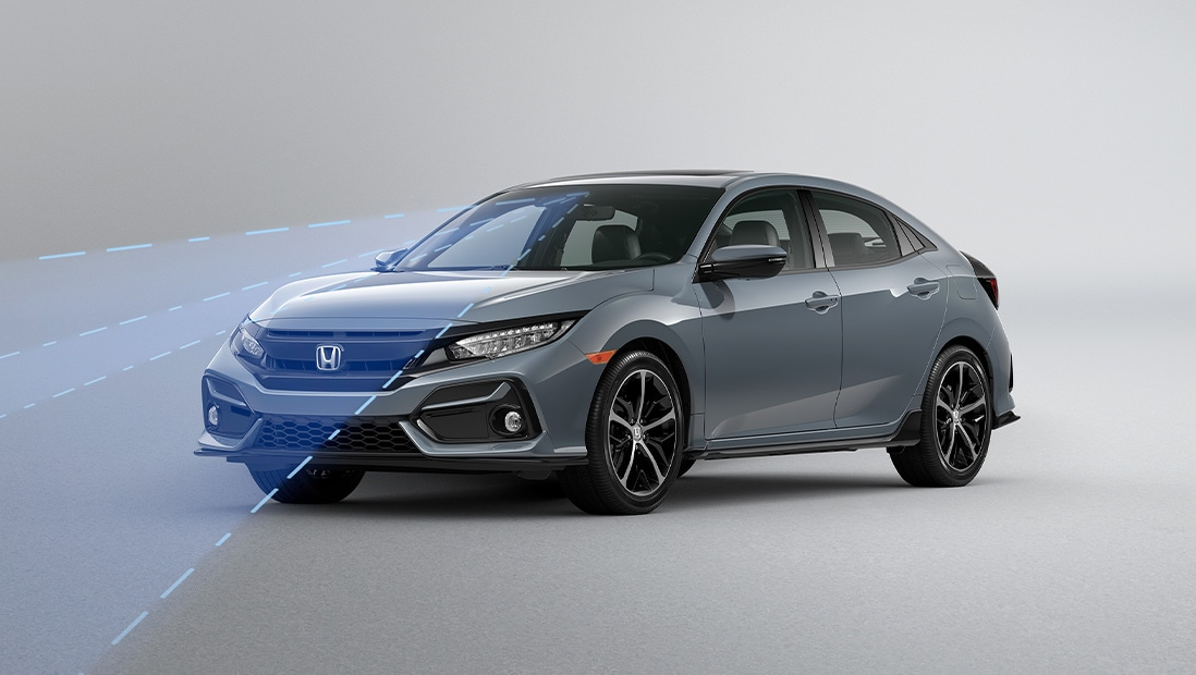 Front 3/4 driver-side view of 2020 Honda Sport Touring Hatchback in Polished Metal Metallic, demonstrating Lane Keeping Assist System.