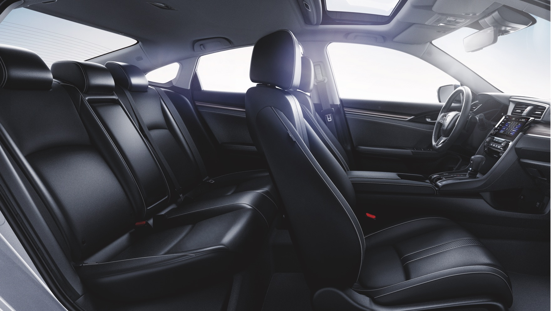 Interior passenger-side view of the front and back seats in the 2020 Honda Civic Touring Sedan with Black Leather.