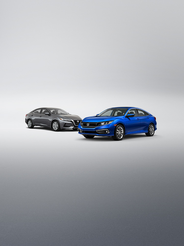 Front passenger-side view of the 2020 Honda Civic Sedan in Aegean Blue Metallic parked in front of competitor vehicle, the 2020 Nissan Sentra.