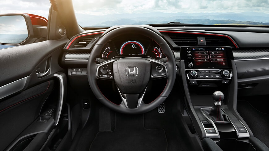 Interior view of instrument panel and steering wheel in Black Cloth on 2020 Honda Civic Si Coupe.