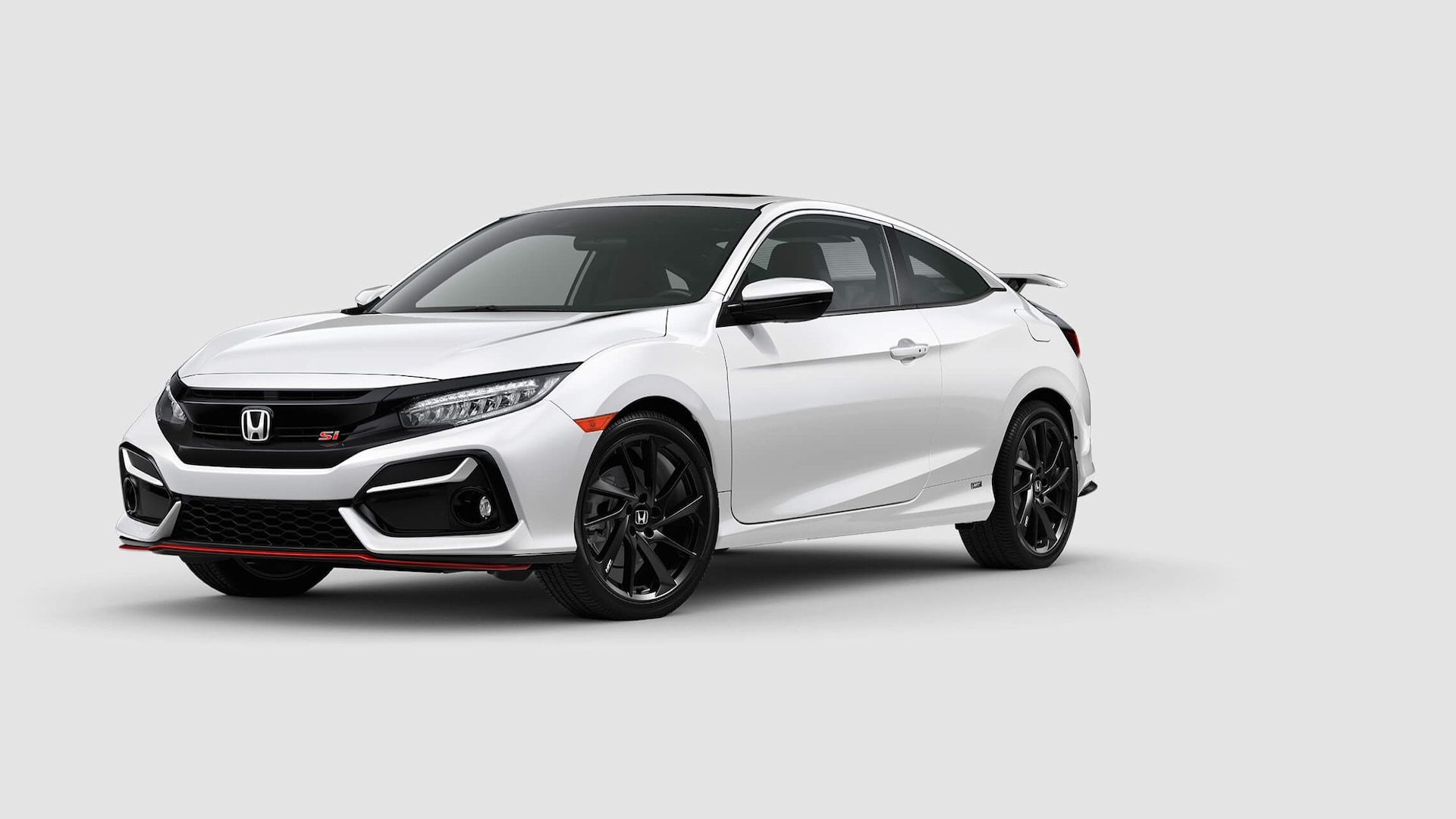 3/4 driver's side close-up view of 2020 Honda Civic Si Coupe in Platinum White Pearl.