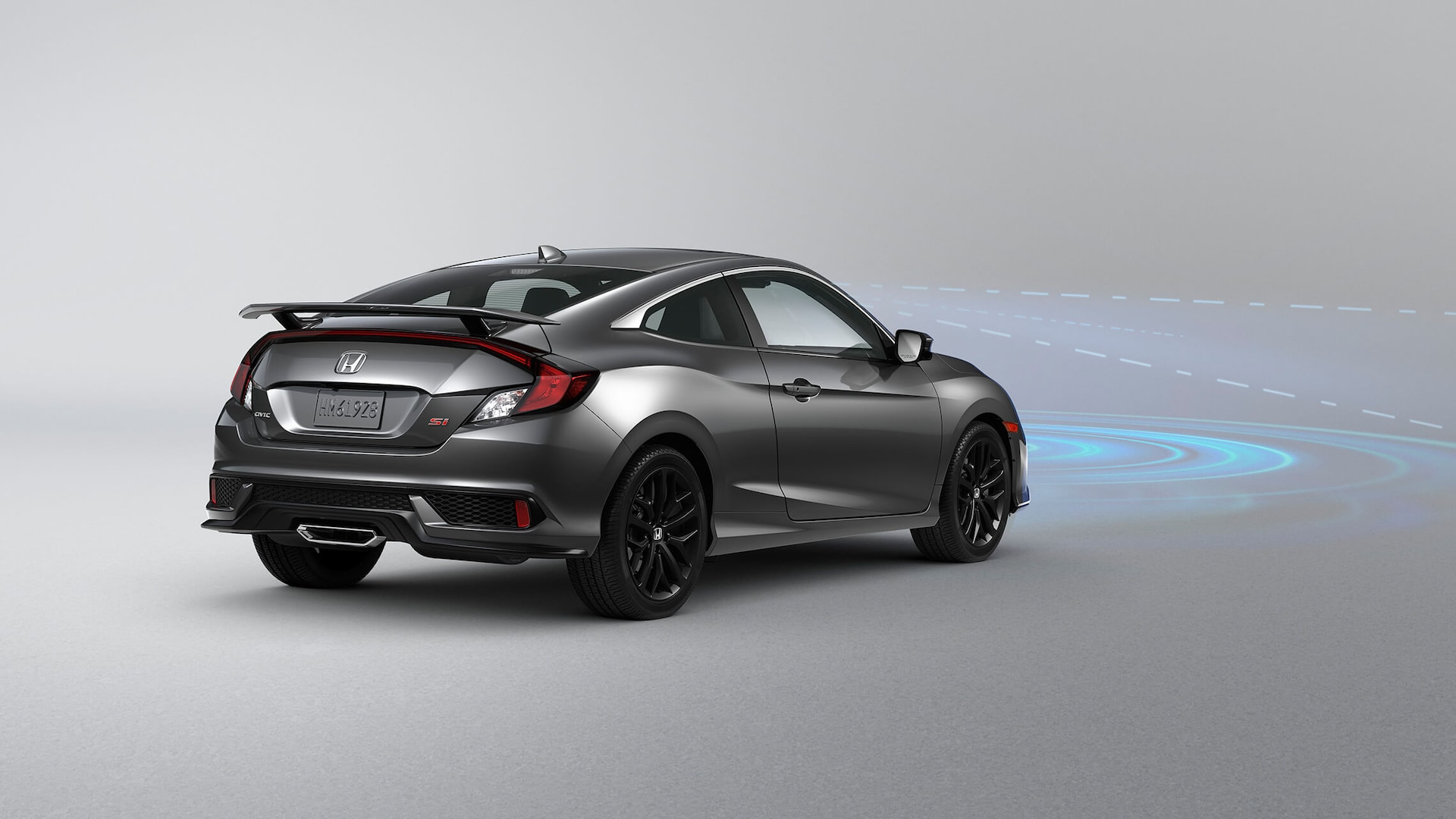 Rear 3/4 passenger's side view of 2020 Honda Civic Si Coupe in Modern Steel Metallic.