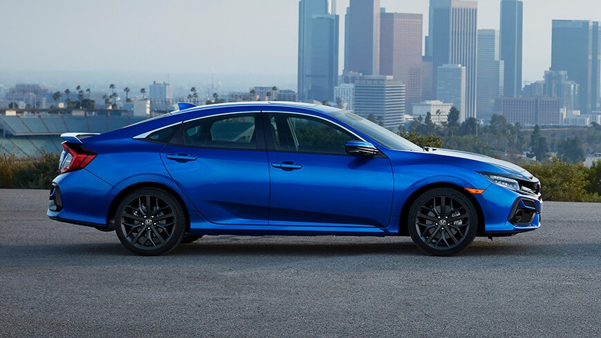 Passenger's side view of 2020 Honda Civic Si Sedan in Aegean Blue Metallic.