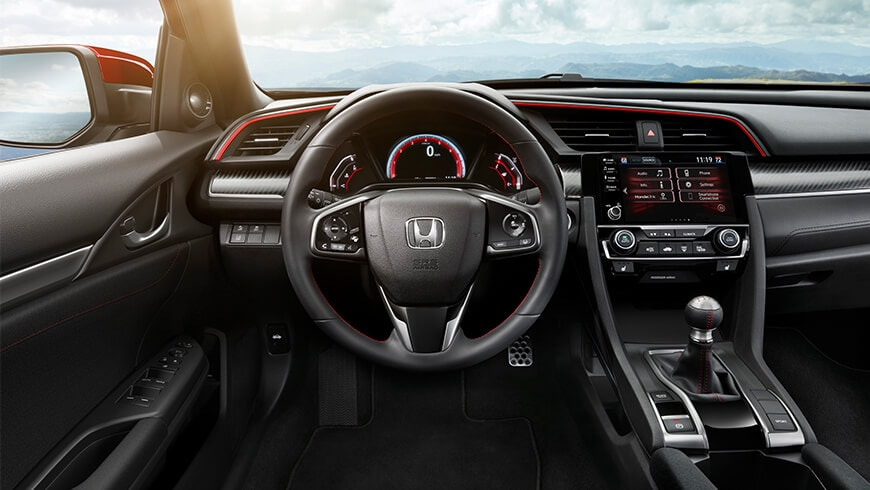 Interior view of instrument panel and steering wheel in Black Cloth on the 2020 Honda Civic Si Sedan.