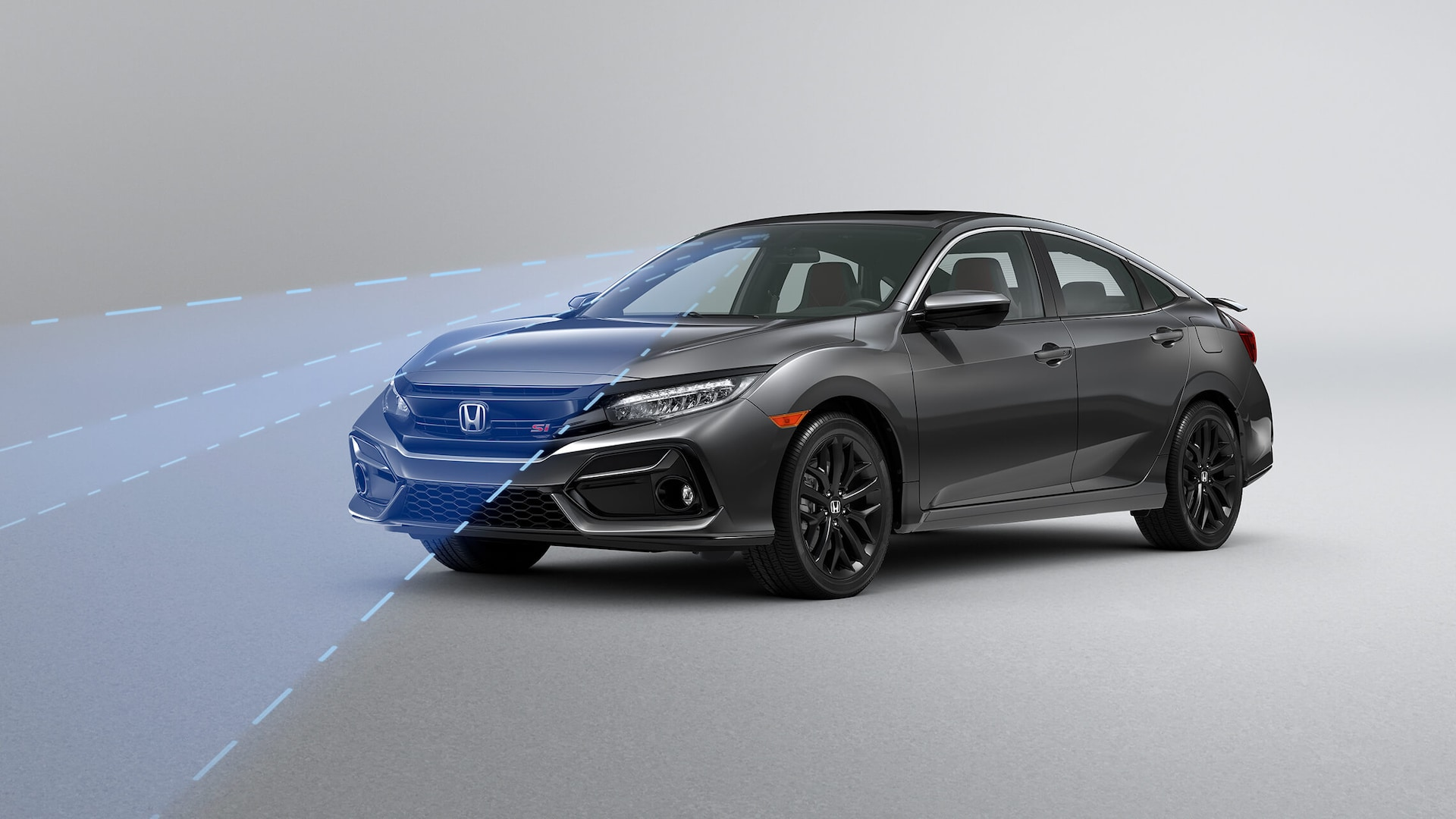 Front 3/4 driver's side view of 2020 Honda Civic Si Sedan demonstrating Road Departure Mitigation System (RDM).