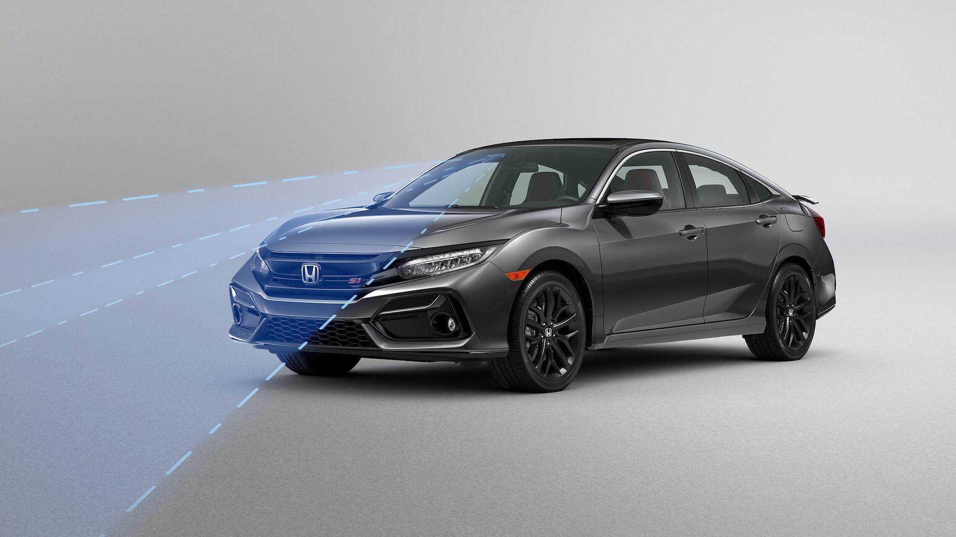 Vista frontal de 3/4 desde el lado del conductor del Honda Civic Si Sedán2020 mostrando el sistema de mitigación de salida de carril (RDM).