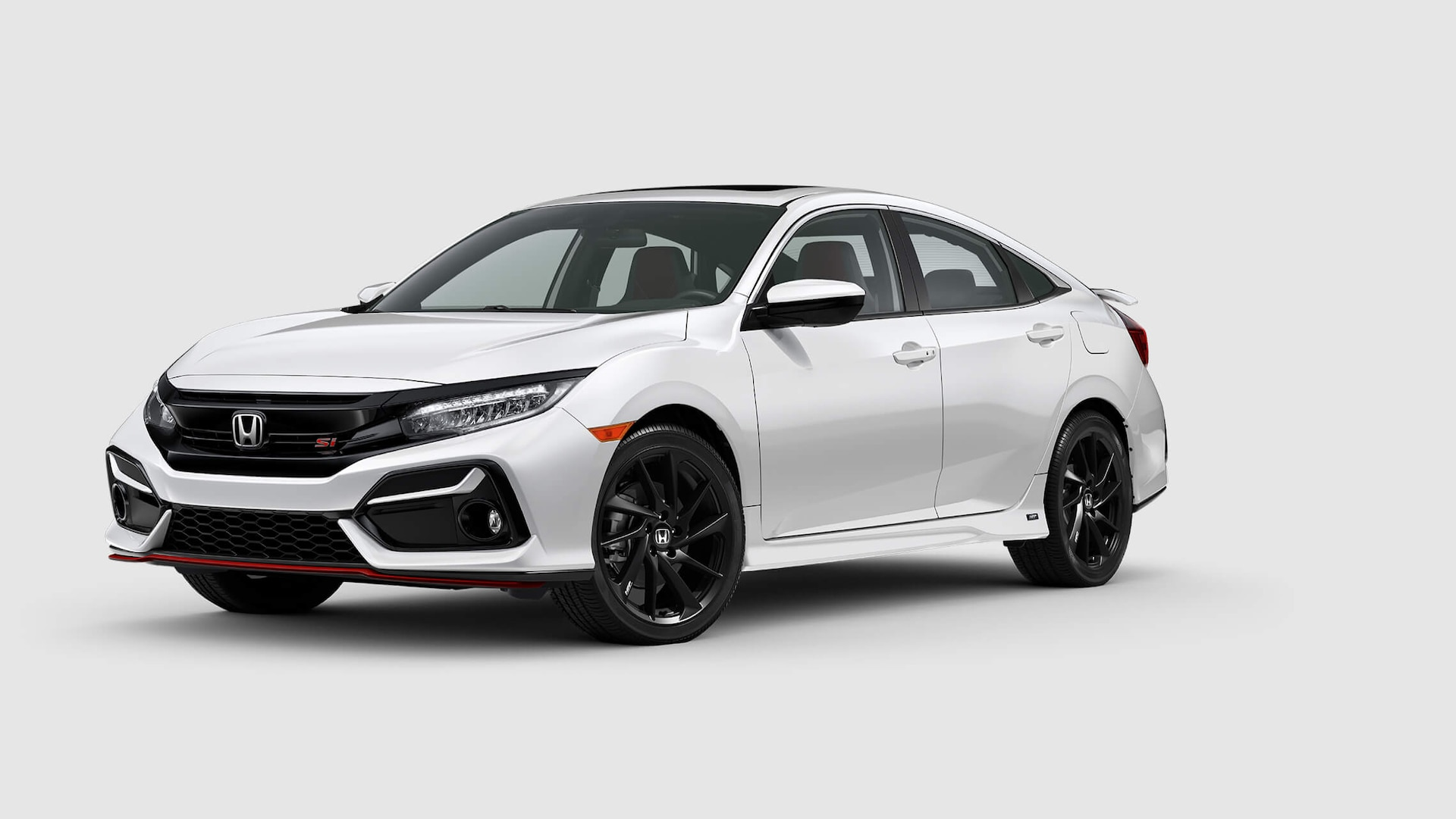 Front 3/4 passenger's side view of 2020 Honda Civic Si Sedan in Platinum White Pearl.