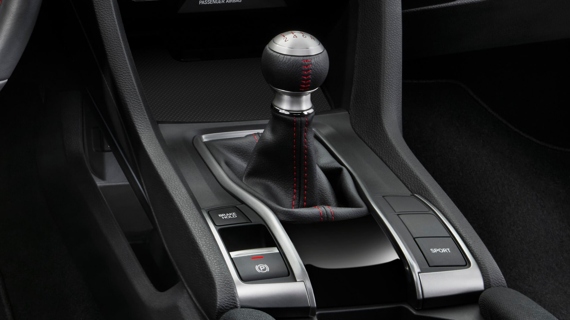 6-speed manual shifter detail with driving mode controls in the 2020 Honda Civic Si Sedan.