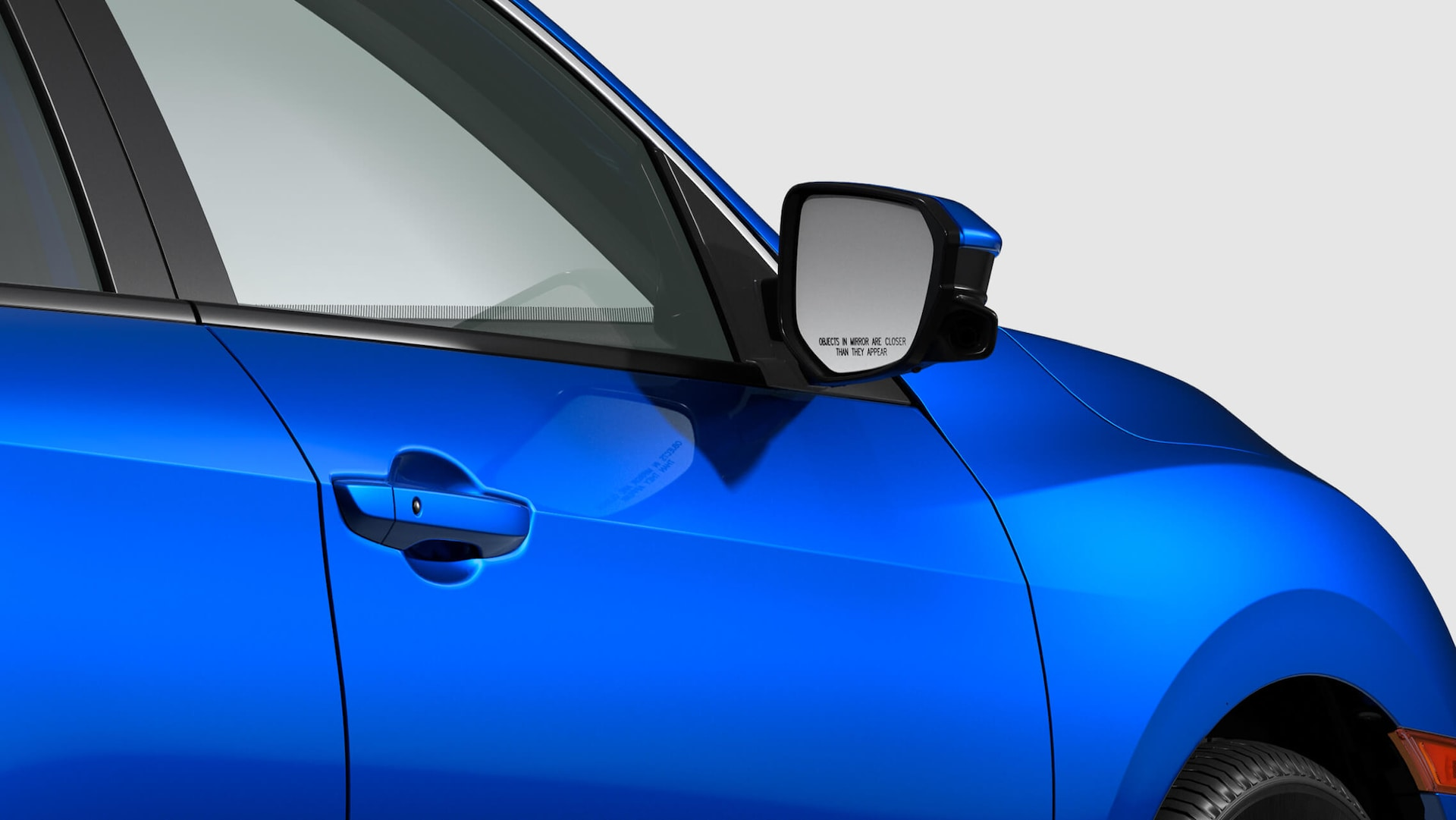 Honda LaneWatch™ camera detail on passenger's side side mirror on 2020 Honda Civic Si Sedan in Aegean Blue Metallic.