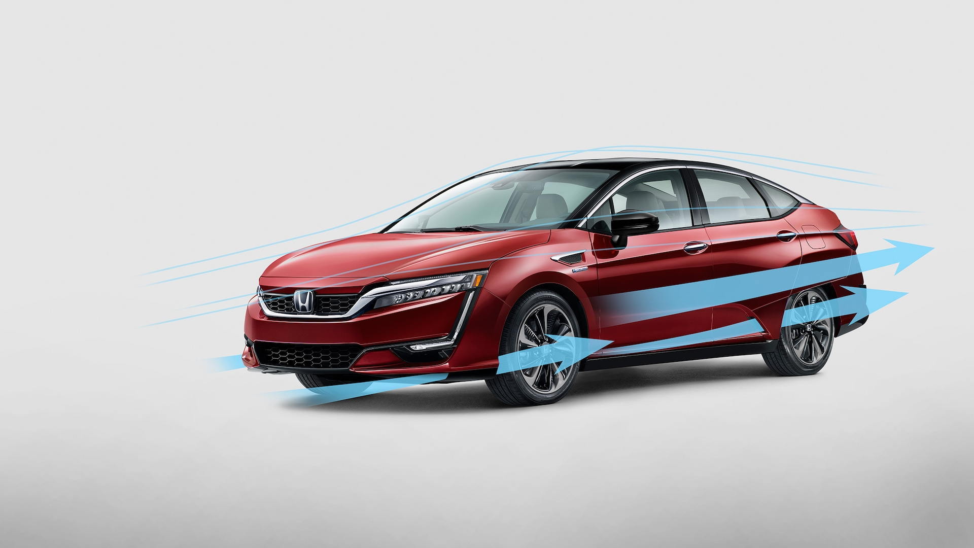 Aerodynamic airflow illustration for front view of 2020 Honda Clarity Fuel Cell in Crimson Pearl.