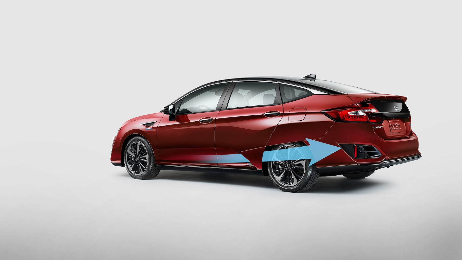 Aerodynamic airflow illustration for rear view of 2020 Honda Clarity Fuel Cell in Crimson Pearl.
