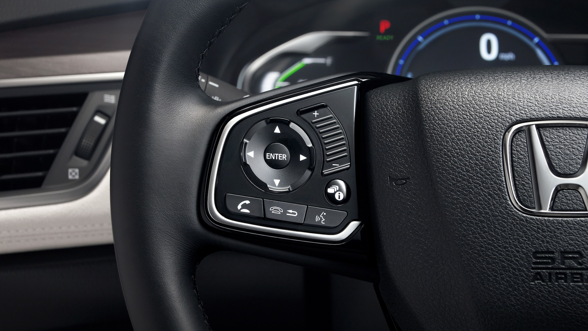 Detail of touch-sensitive steering wheel-mounted controls for 2020 Honda Clarity Fuel Cell.
