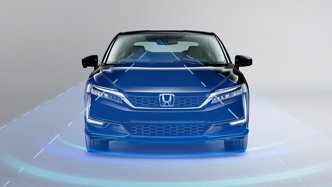 An illustration of the 2019 Honda Clarity Plug-In Hybrid in Crystal Black Pearl using the Adaptive Cruise Control with Low-Speed Follow feature.