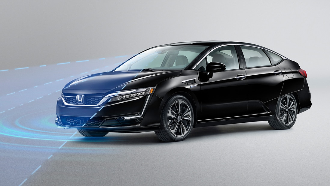 An illustration of the 2019 Honda Clarity Plug-In Hybrid in Crystal Black Pearl using the Road Departure Mitigation System.