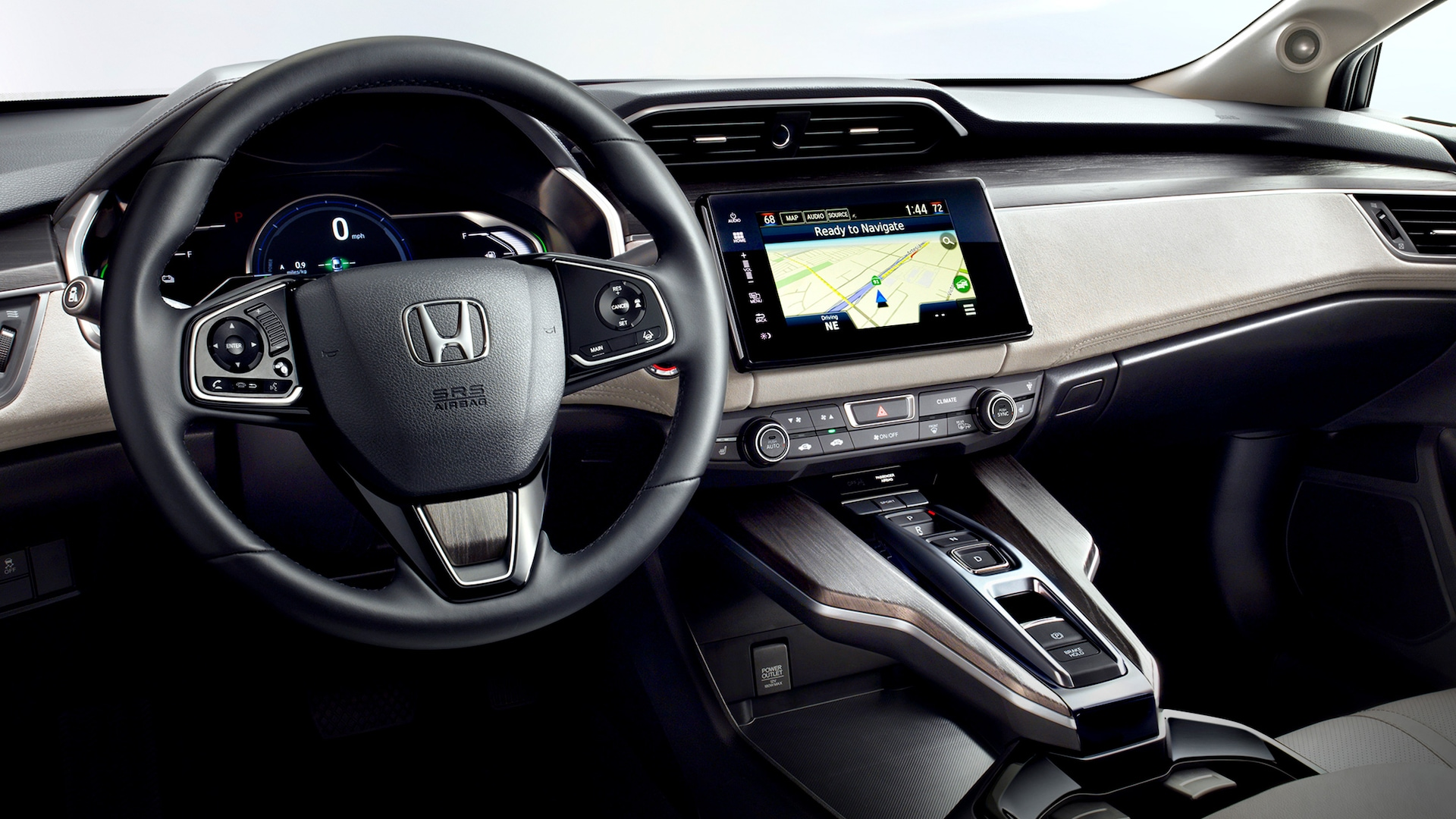 Detail of the steering wheel and interior consoles in the 2020 Honda Clarity Fuel Cell.