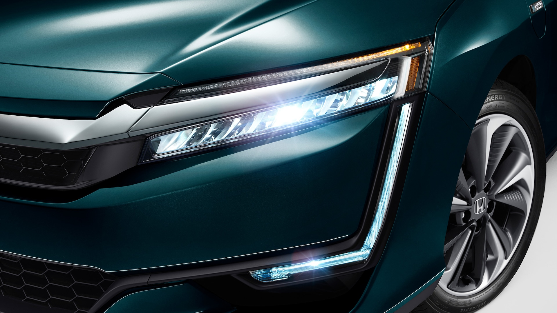 Detail of full LED headlights and DRL on 2020 Clarity Plug-In Hybrid in Moonlit Forest Pearl.