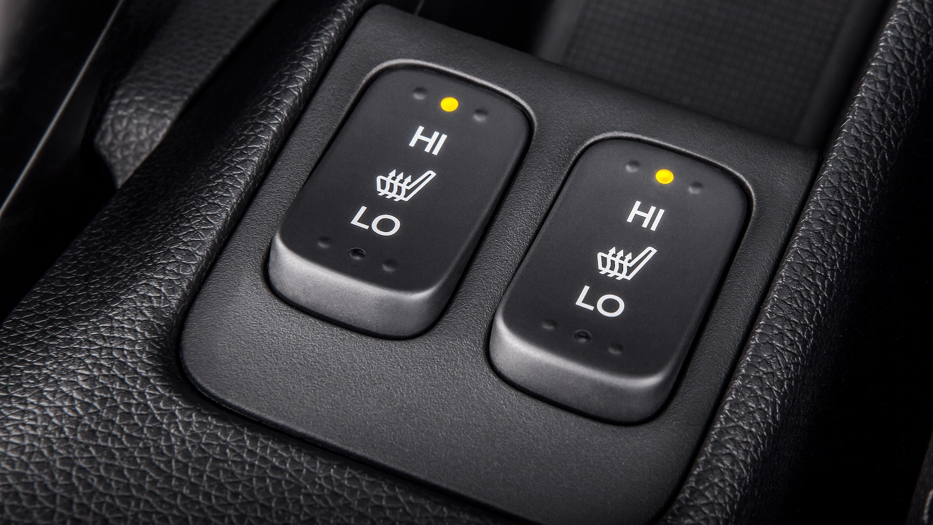Heated front seat control button detail on 2020 Honda Fit EX-L.