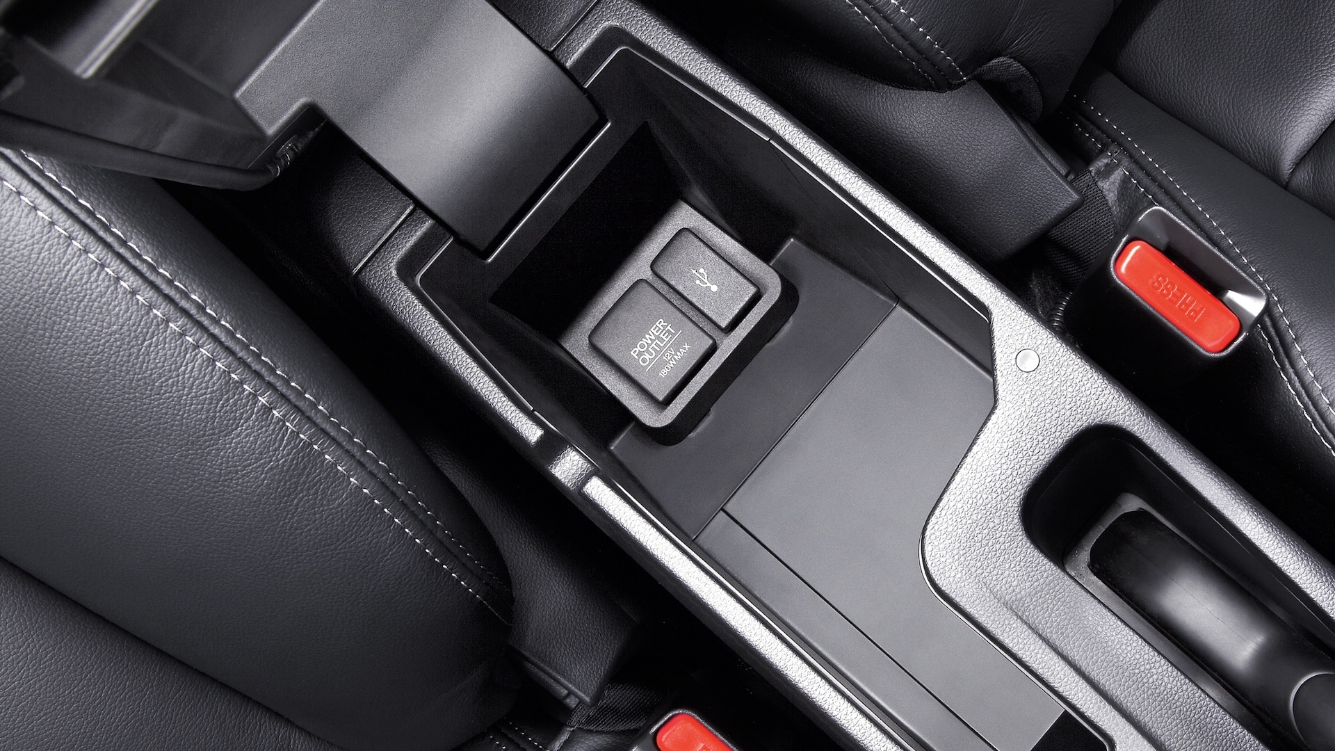 USB port detail in open center console of the 2020 Honda Fit EX-L with Black Leather.