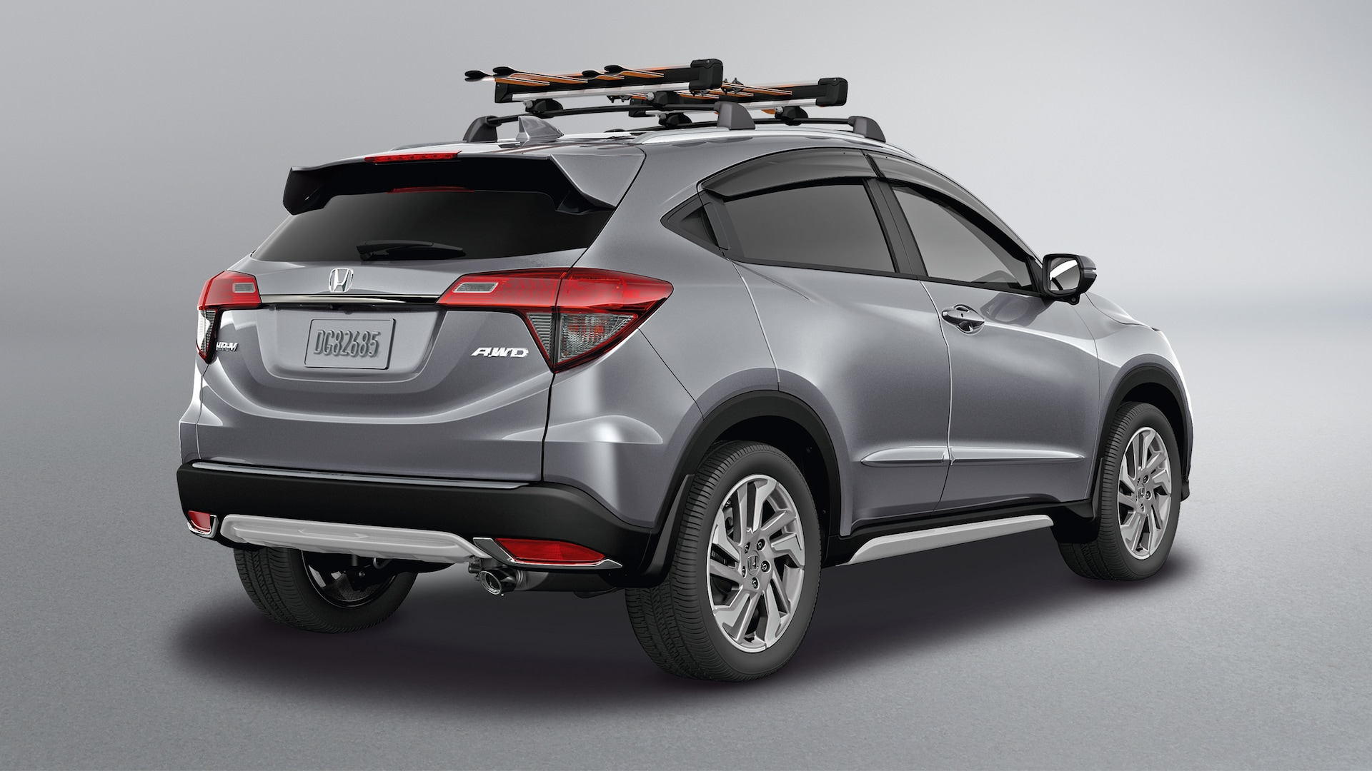 Rear 3/4 passenger-side view of the 2020 Honda HR-V EX in Lunar Silver Metallic with Honda Genuine Accessories.