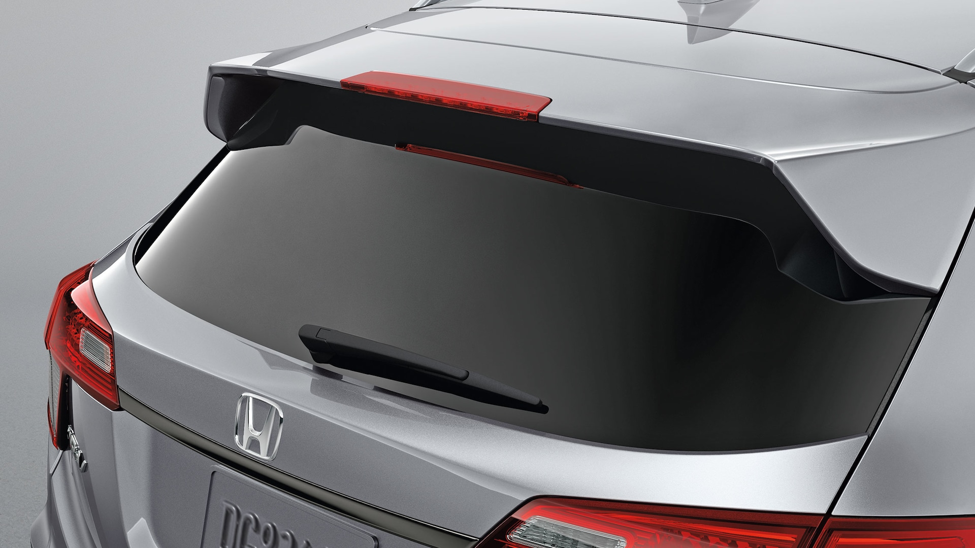 Accessory tailgate spoiler detail on the 2020 Honda HR-V in Lunar Silver Metallic.