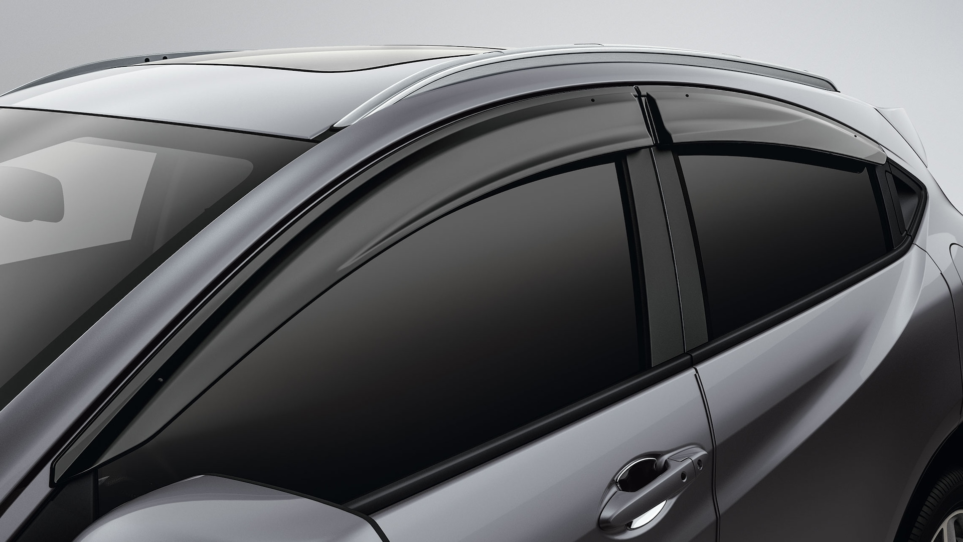 Window visor detail on the 2020 Honda HR-V EX-L in Lunar Silver Metallic.