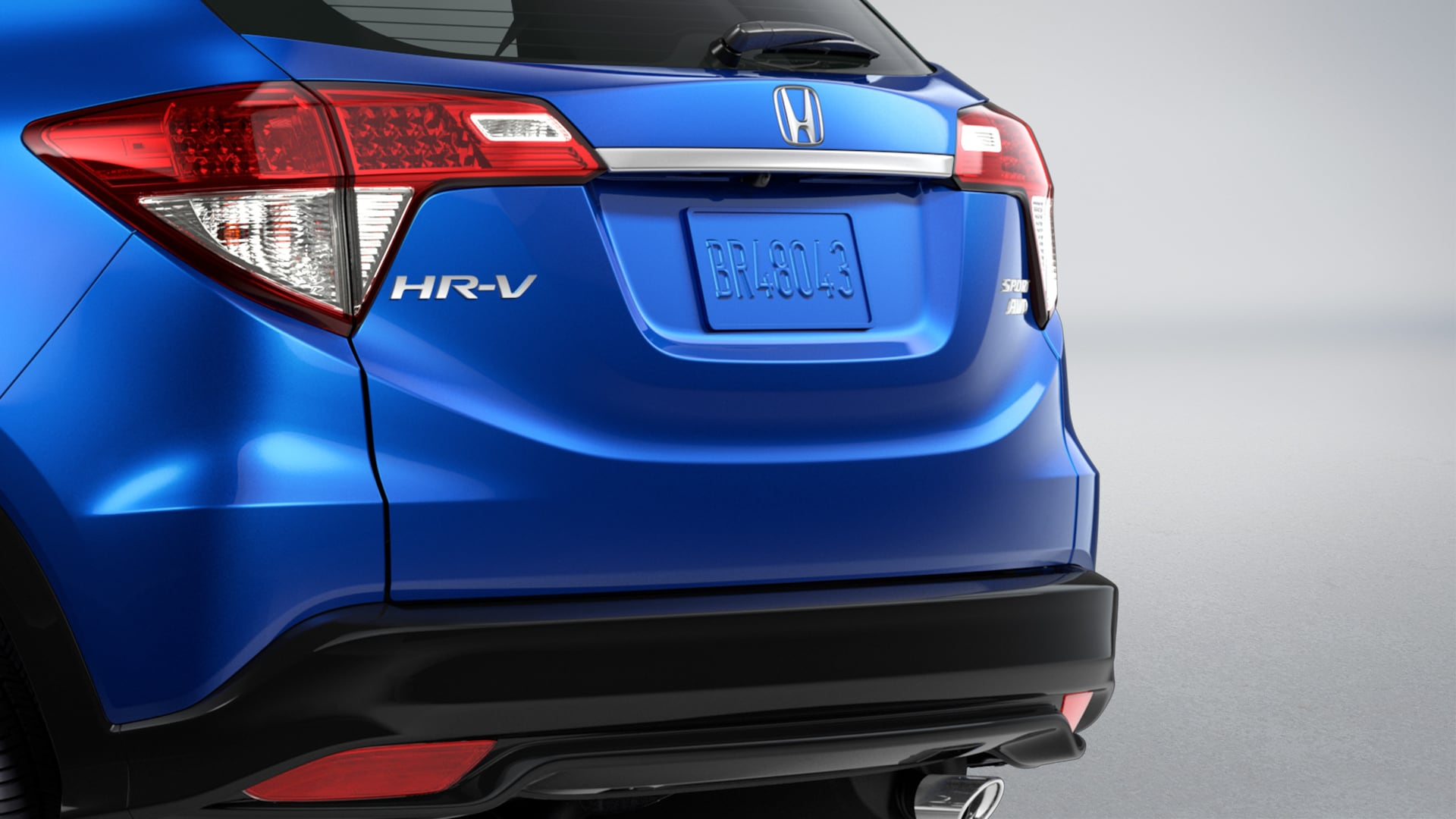 Rear 3/4 passenger-side view of brake light detail on the 2020 Honda HR-V Sport in Aegean Blue Metallic.