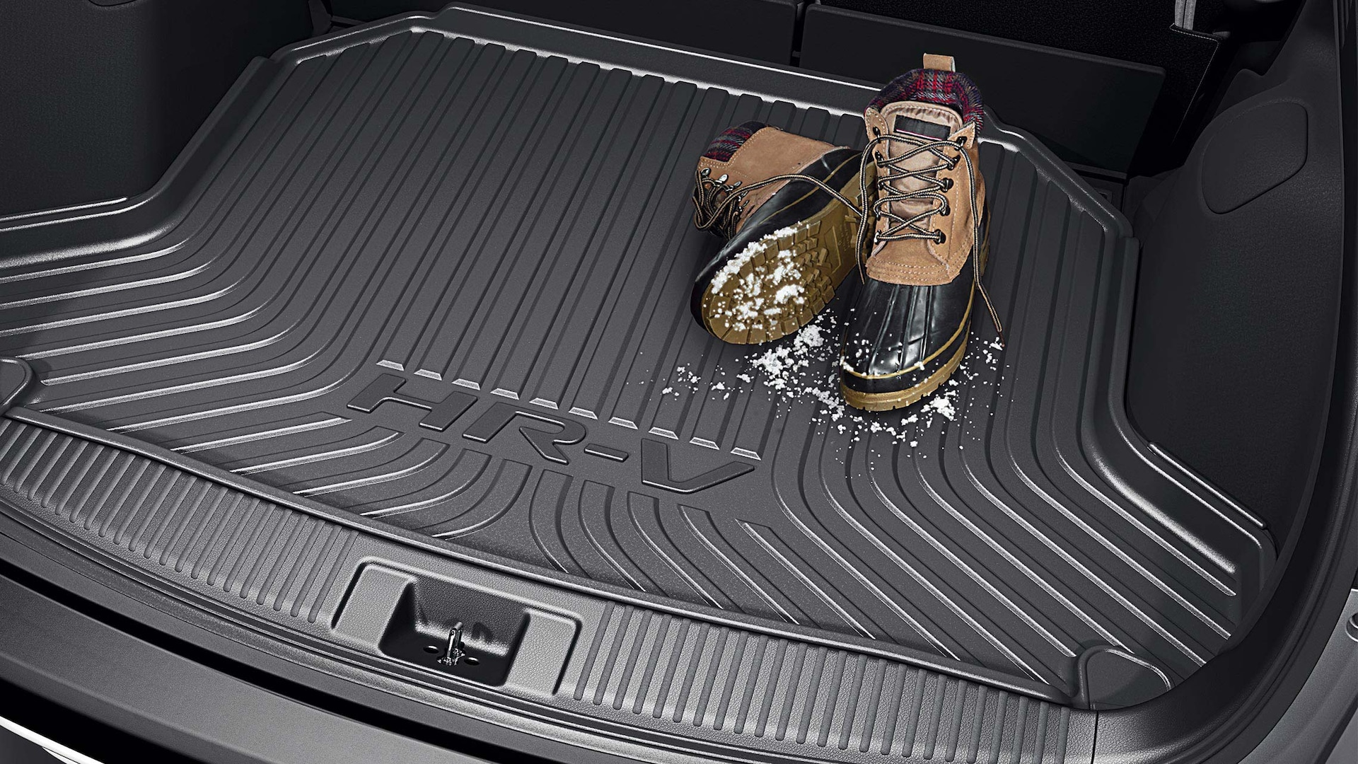 Detail view of cargo tray storing snow boots in the 2020 Honda HR-V.