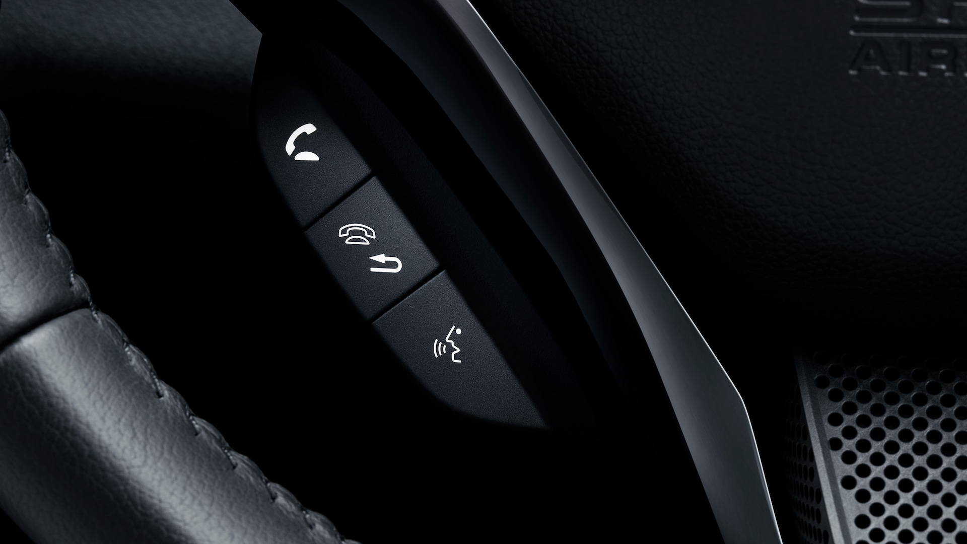 Detail view of Bluetooth® HandsFreeLink® feature on steering wheel in the 2020 Honda HR-V Touring.