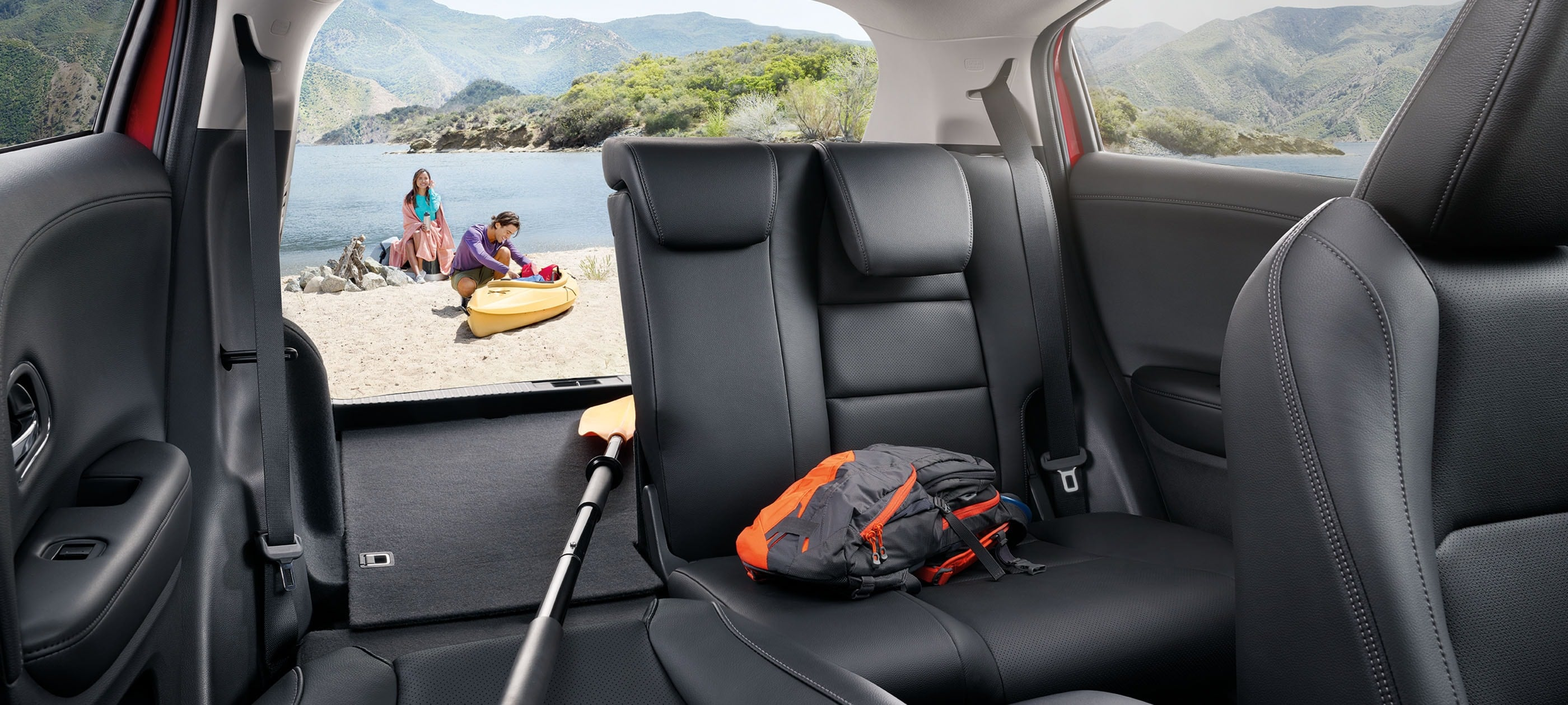 Front interior view of rear seats in 2020 Honda HR-V Touring with Black Leather displaying cargo volume.